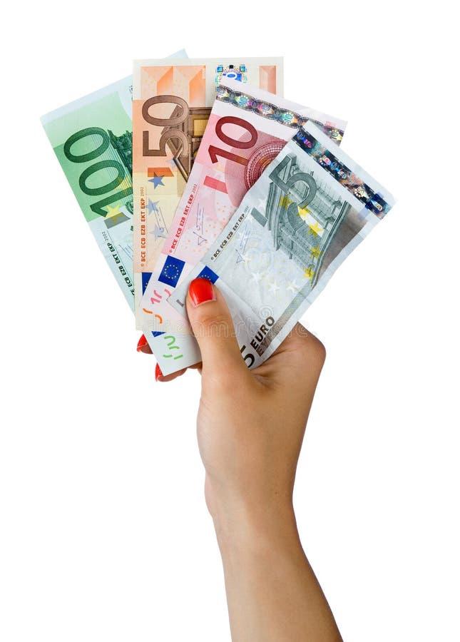 Mão da mulher com euro- contas imagens de stock royalty free