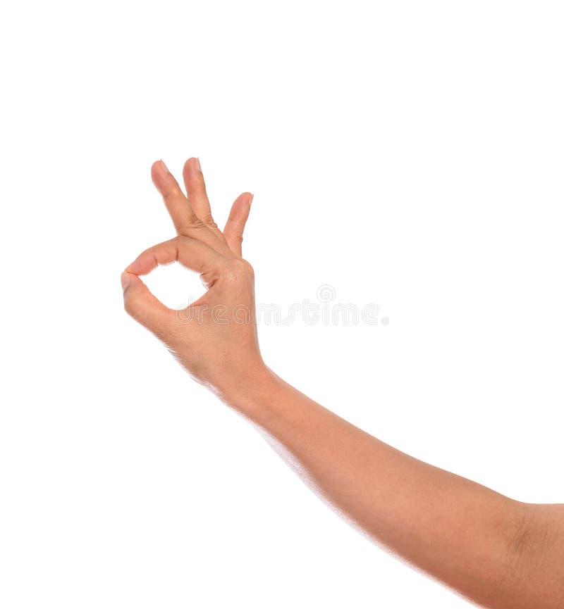 Mão da mulher com gesticular o sinal aprovado isolado imagens de stock royalty free
