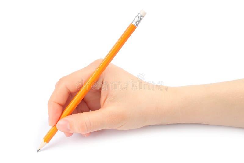 Mão da mulher com lápis fotos de stock
