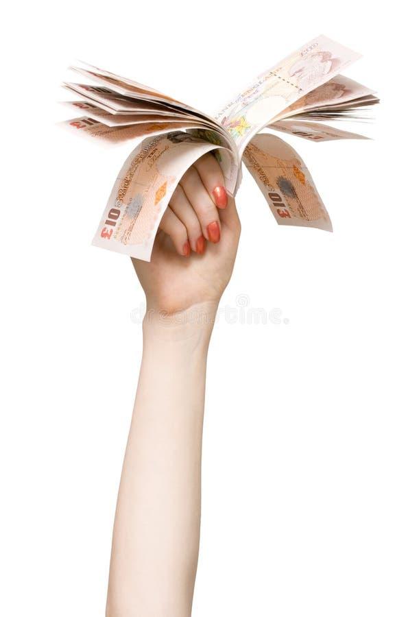 Mão da mulher com libras imagens de stock royalty free