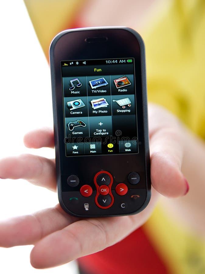 Mão da mulher com telefone móvel fotografia de stock royalty free