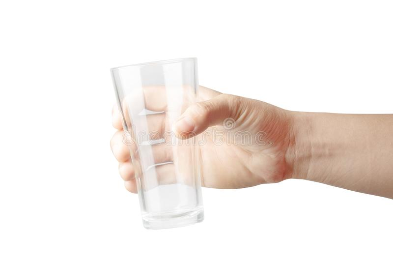A mão da mulher está mantendo o vidro vazio isolado no fundo branco fotos de stock royalty free