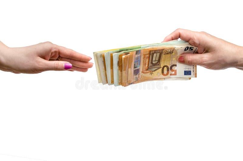 Mão da mulher que dá a pilha do euro foto de stock royalty free