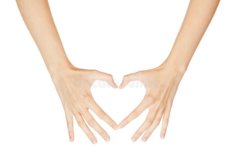 Mão da mulher que faz o coração do sinal foto de stock