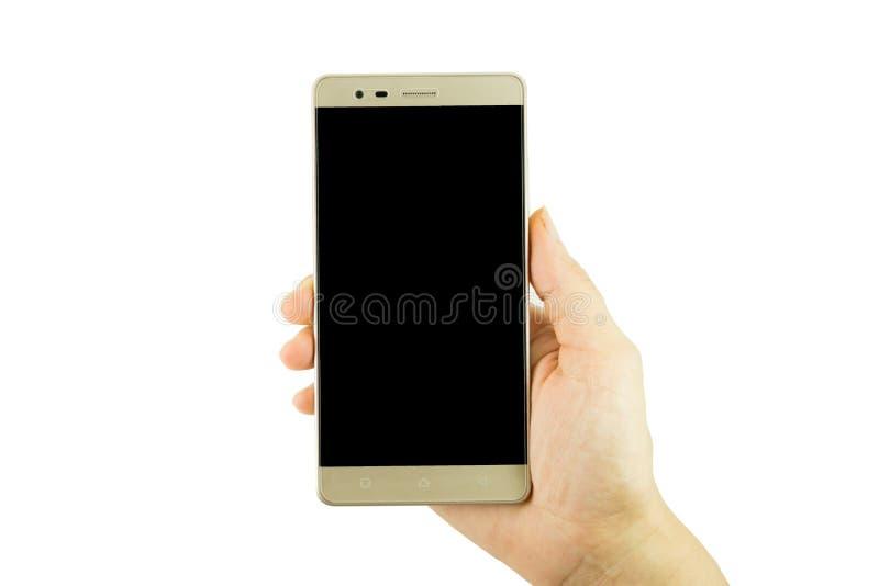 Mão da mulher que guarda o smartphone dourado no fundo branco imagens de stock royalty free