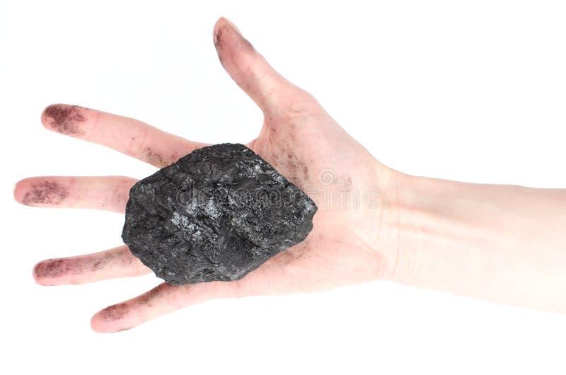 Mão da mulher que guarda a protuberância de carvão no fundo branco imagem de stock