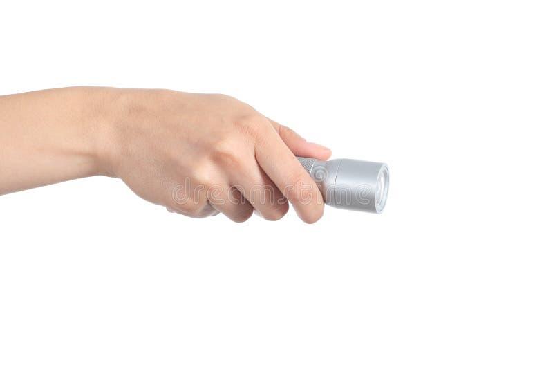 Mão da mulher que guarda uma lanterna elétrica imagem de stock