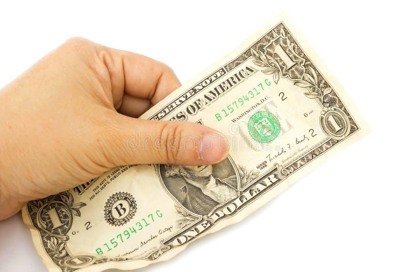 A mão da mulher que guarda uma uma nota de dólar amarrotada no backgro branco fotografia de stock