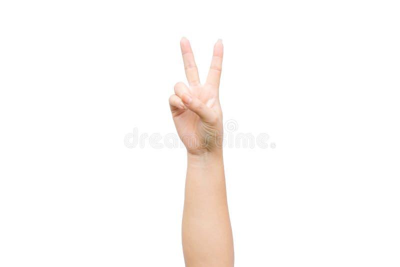 Mão da mulher que mostra dois dedos como o sinal da vitória imagens de stock royalty free