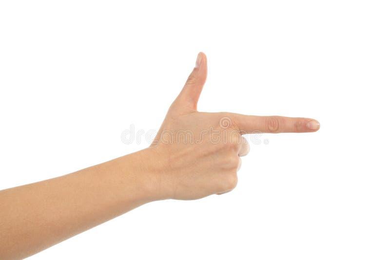 Mão da mulher que mostra o forefinger no sinal da arma imagem de stock royalty free