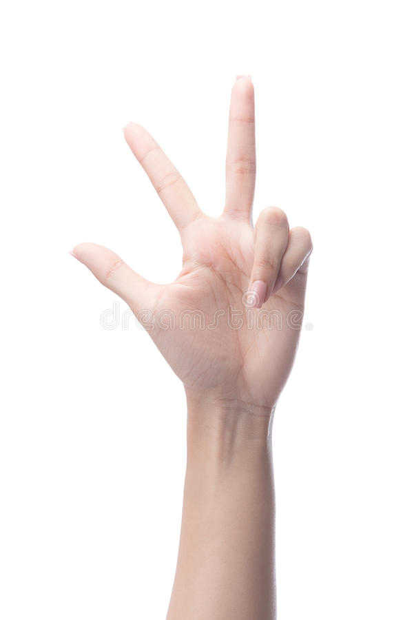 Mão da mulher que mostra três dedos, número 3 imagens de stock