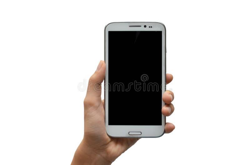 Mão da mulher usando o tela táctil do telefone celular fotos de stock royalty free