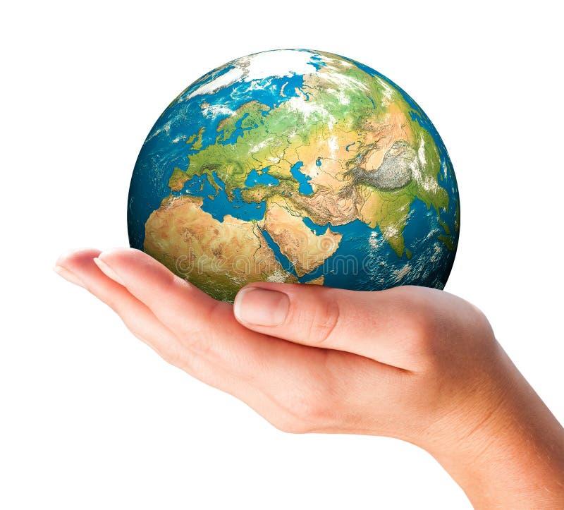 A mão da pessoa guarda o globo. fotografia de stock royalty free