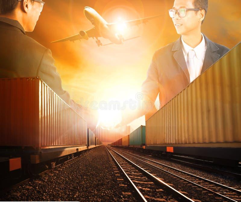 Mão de agitação bem sucedida do homem de negócio dois com o a logístico railway fotografia de stock royalty free