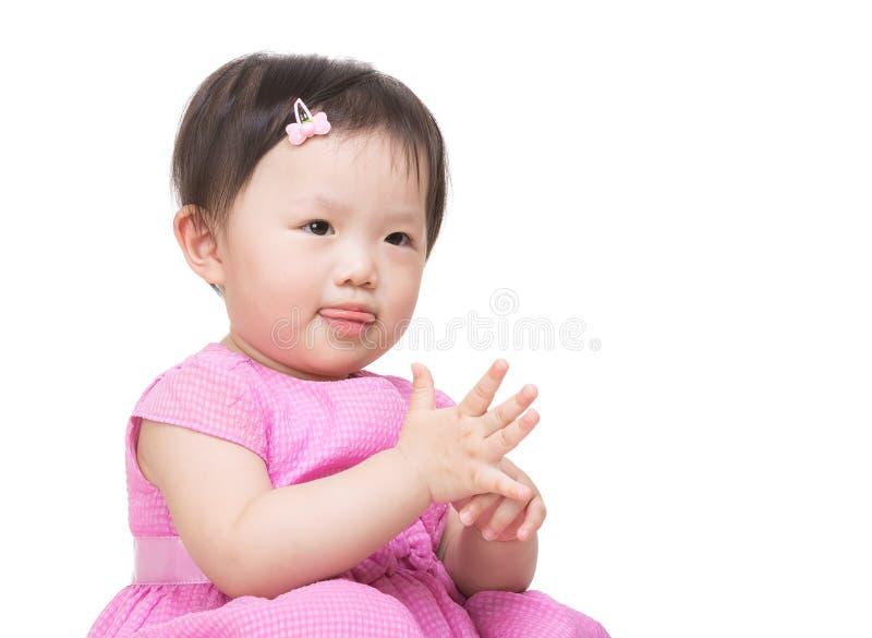 Mão de aplauso da menina asiática fotografia de stock