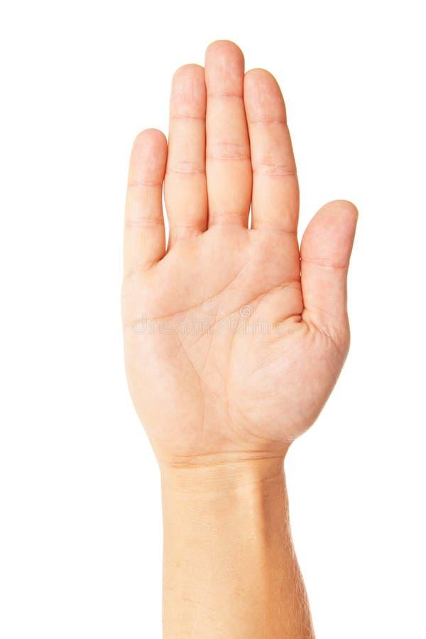 A mão de homem de negócio faz o símbolo da parada isolada imagem de stock royalty free