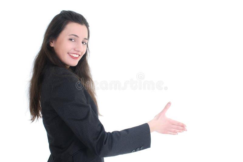 Mão de oferecimento da mulher de negócios nova imagem de stock