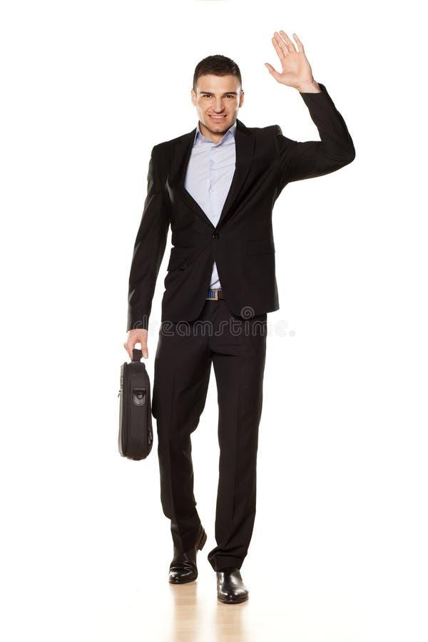 Mão de ondulação do homem de negócios imagens de stock royalty free