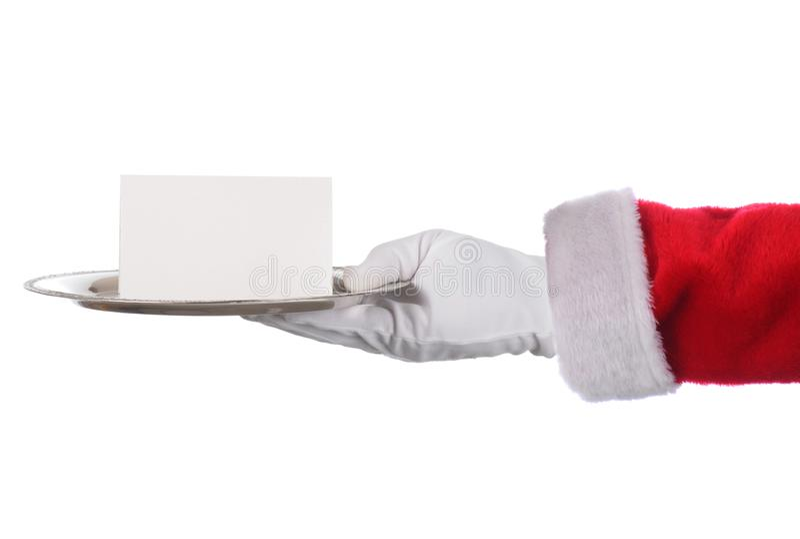 Mão de Santa Claus que guarda a bandeja de prata e a nota vazia Braço do formato horizontal com mão somente fotografia de stock