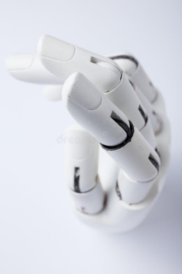 Mão de um robô em um fundo branco ilustração stock
