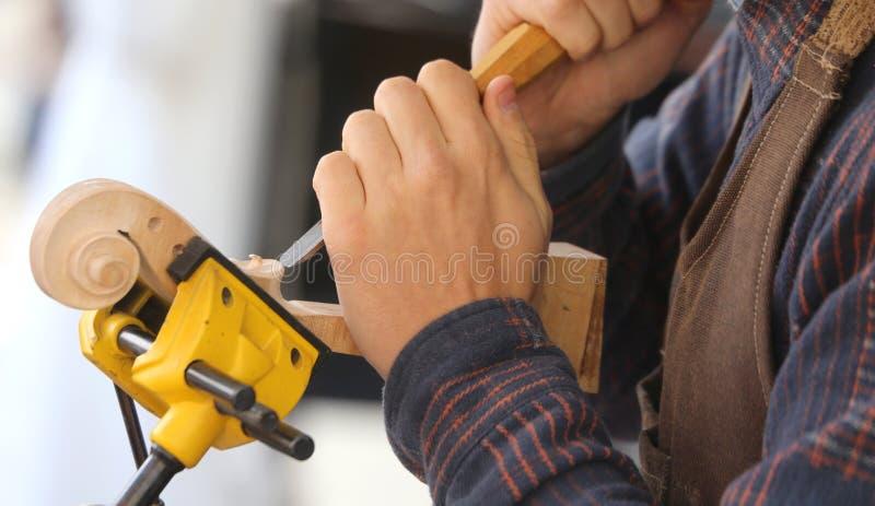 Mão de uma atração perita no trabalho imagem de stock royalty free