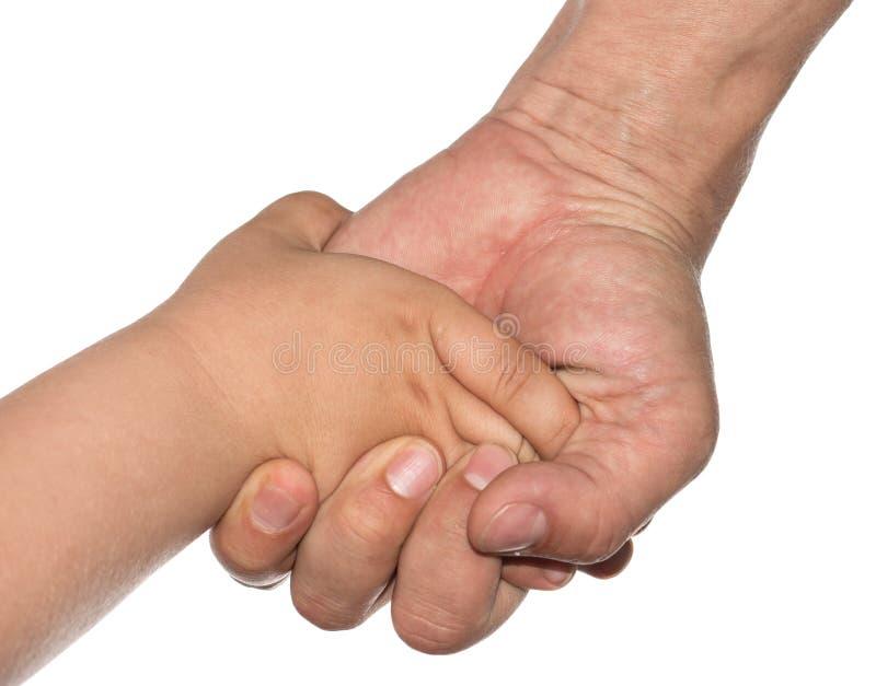 Mão de uma criança e de um pai em um fundo branco foto de stock