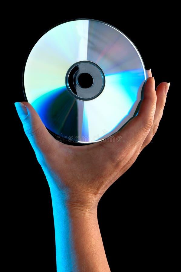 Mão de uma mulher que prende um disco compacto foto de stock royalty free