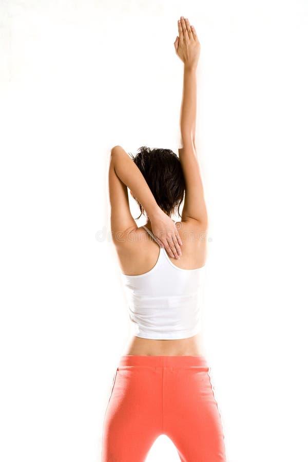 Mão do estiramento da mulher da ioga em linha reta fotos de stock royalty free