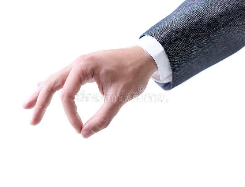 Mão do homem de negócio que mantém algo isolado em um backgrou branco fotos de stock