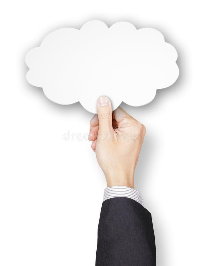 Mão do homem de negócios que guarda o papel da bolha do pensamento fotos de stock