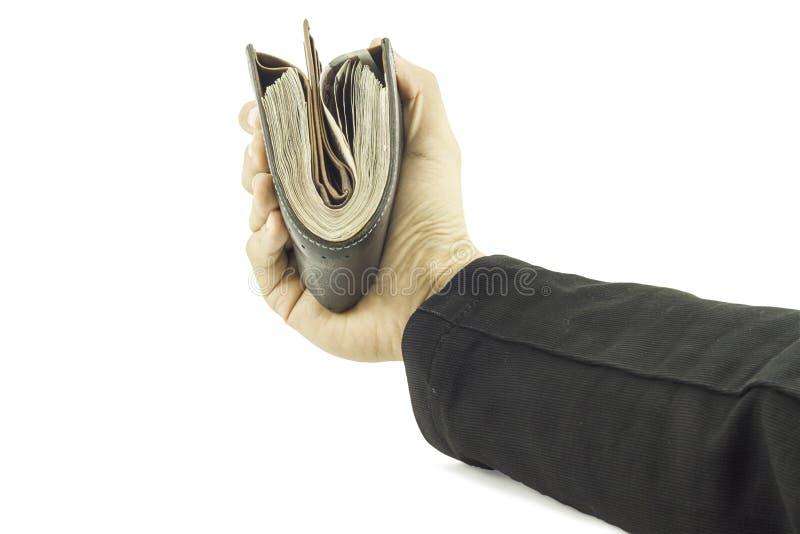 Mão do homem de negócios que mantém o dinheiro e o homem que mantêm uma carteira isolada no fundo branco imagem de stock