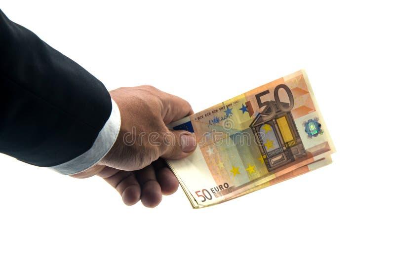Mão do homem de negócios que mantém o euro- dinheiro das cédulas isolado no fundo branco fotografia de stock royalty free