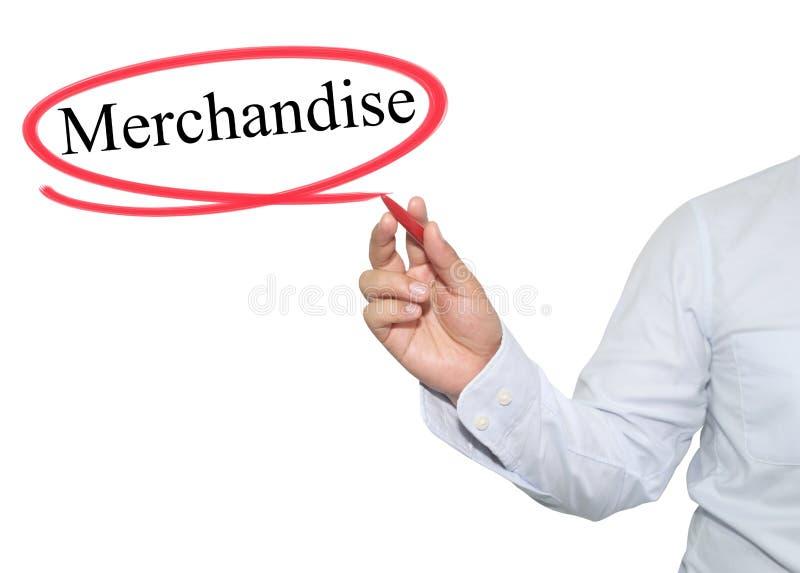A mão do homem escreve a mercadoria do texto com cor preta isolada sobre imagens de stock