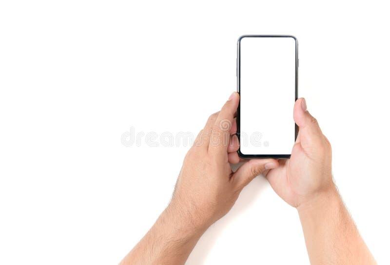 Mão do homem que guarda o smartphone preto imagens de stock royalty free