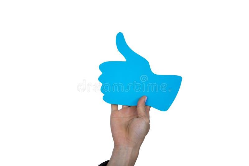 A mão do homem que guarda os polegares levanta a placa do sinal fotografia de stock