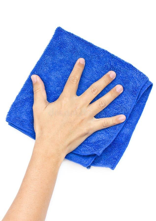A mão do homem que limpa a superfície. imagens de stock royalty free
