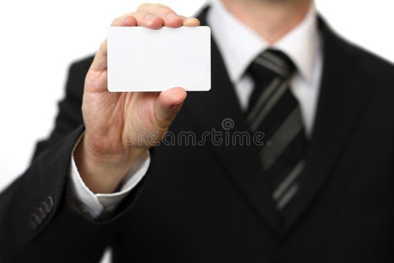 A mão do homem que mostra o cartão fotos de stock