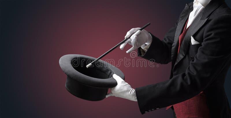 A mão do ilusionista quer s conjurar algo imagens de stock royalty free