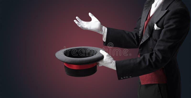 A mão do ilusionista quer s conjurar algo imagens de stock