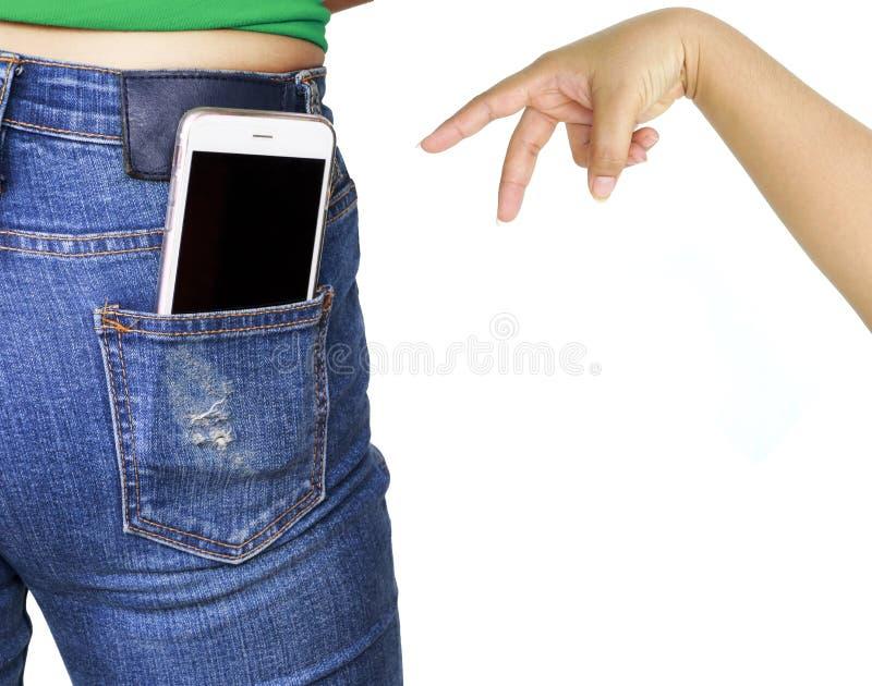 Mão do ladrão que tenta roubar o telefone celular fotografia de stock royalty free