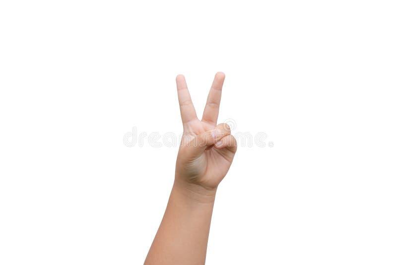 Mão do menino que mostra dois dedos como o sinal da vitória no fundo branco fotografia de stock royalty free