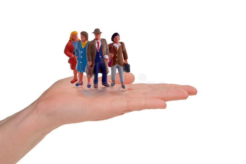 Mão do negócio com trabalhadores imagem de stock