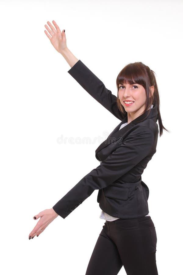 Mão do ponto da mulher de negócios para esvaziar o espaço da cópia, fundo branco imagem de stock
