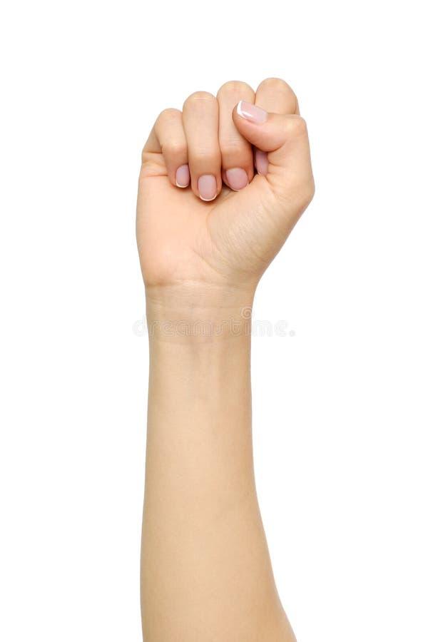 Mão do ` s da mulher com gesto do punho imagem de stock