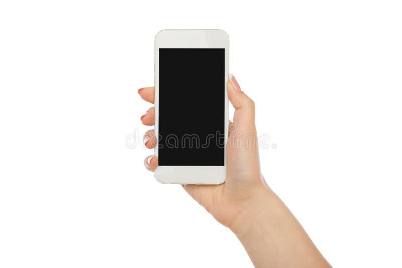 A mão do ` s da mulher que guarda o telefone celular, colheita, cortou fotos de stock