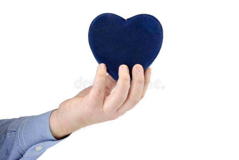 Mão e coração de Man's fotografia de stock royalty free