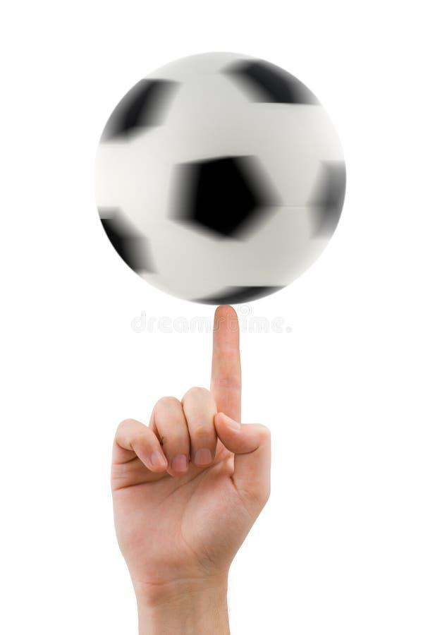 Mão e esfera de futebol de giro fotografia de stock
