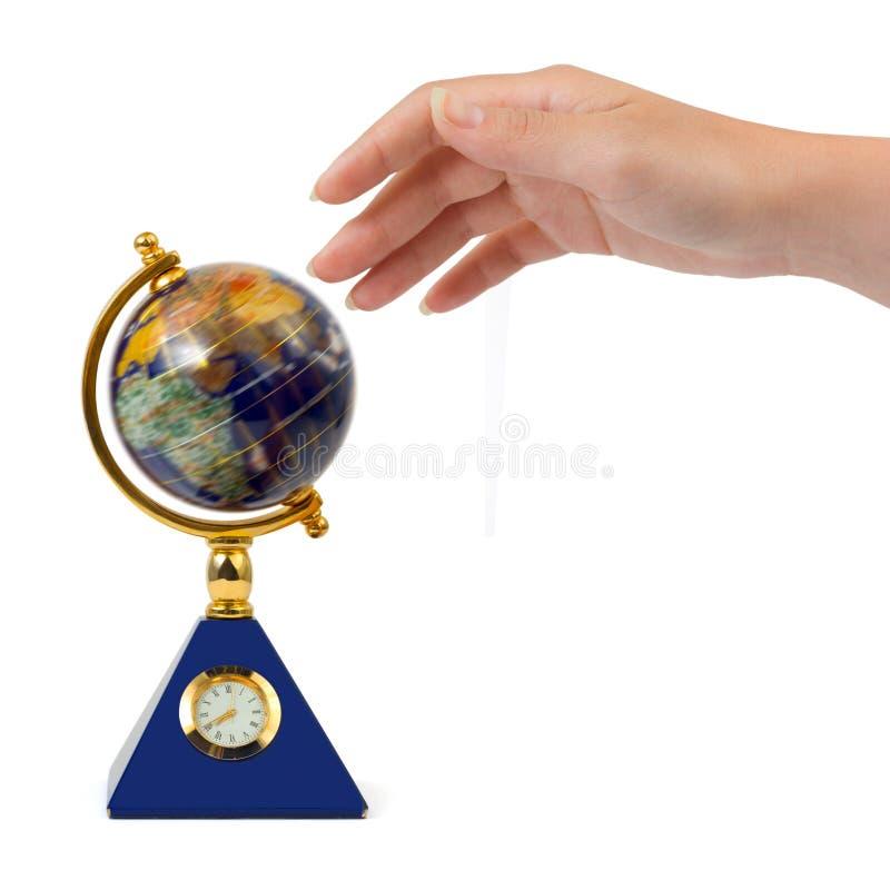 Mão e globo de giro foto de stock royalty free