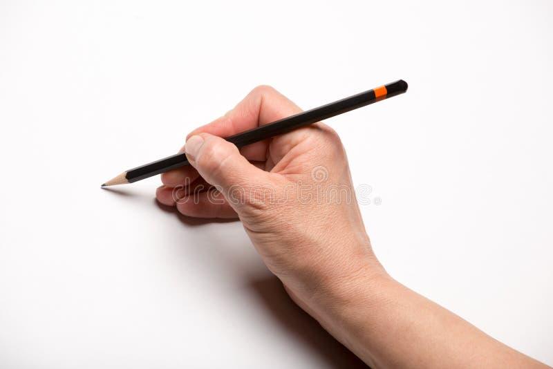 Mão e lápis fotografia de stock royalty free