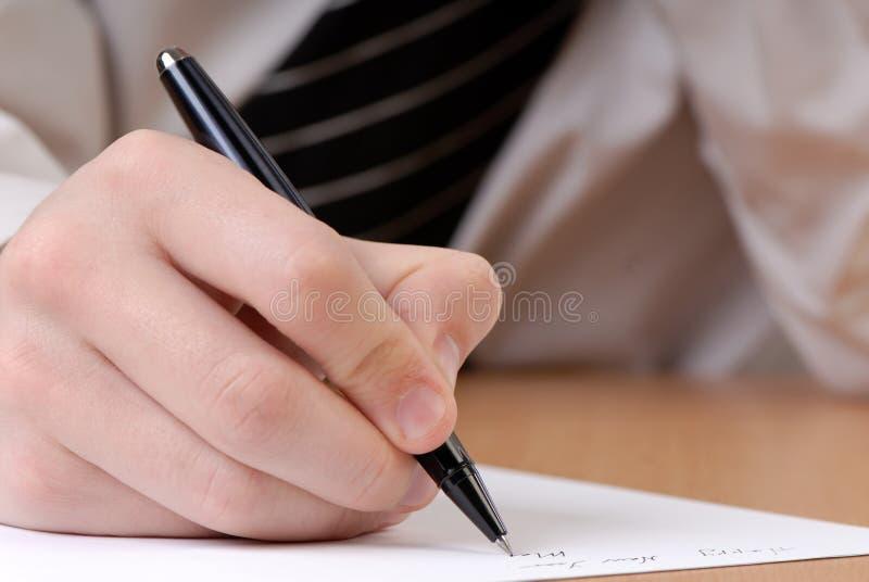 Mão e lápis fotos de stock royalty free